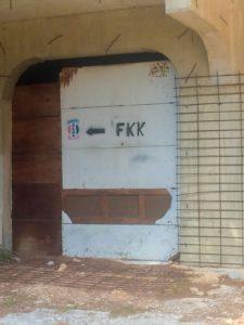"Spray painted ""FKK"" sign"