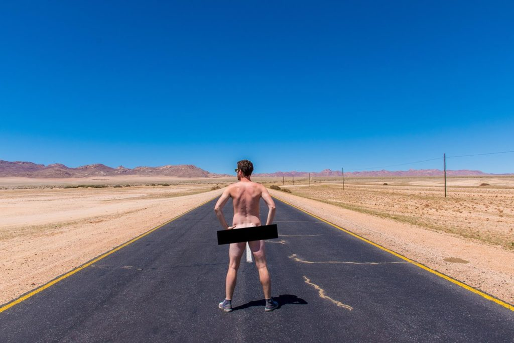 Naked in the middle of the road