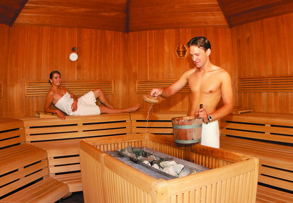 relaxing in a coed sauna